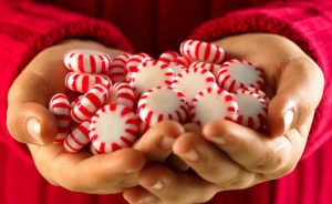 getty_rf_photo_of_hands_with_peppermints